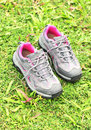 Running shoes on grass Stock Photo