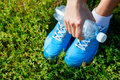 Running shoes on grass concept closeup of image Stock Photos