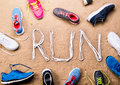 Running shoes and run sign made of shoelaces, sand Royalty Free Stock Photo