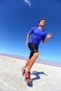 Running sport athlete man sprinting in trail run desert male fitness runner sprint workout training compression shorts Stock Photography
