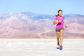 Running sport athlete woman sprinting in trail run desert female fitness runner sprint workout training shorts and t Stock Photos