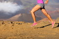 Running sport fitness woman closeup of female legs and shoes in action girl athlete runner sprinting fast outside in Stock Photo