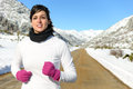 Running sport on winter woman in cold in snowy mountain country side road female athlete in warm sportswear and gloves training Royalty Free Stock Photos