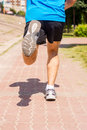 Running In Sports Shoes.