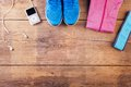 Running stuff on the floor various lined up a wooden background Stock Photography