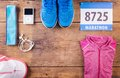 Running stuff on the floor various lined up a wooden background Royalty Free Stock Photography
