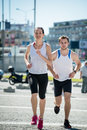 Running together young sport couple jogging in city environment Royalty Free Stock Photography