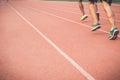 Running track with blur of runner feet in stadium