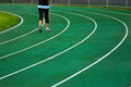 Running track green athletic with in the distance Royalty Free Stock Photography