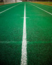 Running track green athletic with white line Royalty Free Stock Images