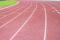 Running track and green grass Stock Photos