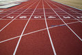 Running track lanes of a red race with numbers Stock Photography