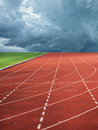 Running track leading to storm towards clouds Royalty Free Stock Images