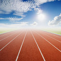 Running track with one lanes with blue sky Stock Photos