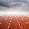 Running track with one lanes with raincloud rain cloud Royalty Free Stock Photo
