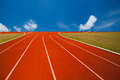 Running track over blue sky and clouds athlete or Royalty Free Stock Photography