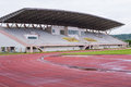 Running track and stadium field after rain Royalty Free Stock Image
