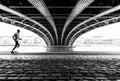 Running under the bridge Royalty Free Stock Photo