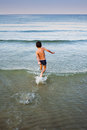 Running into water boy sea Royalty Free Stock Image