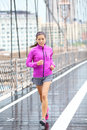 Running woman jogging in new york city training for marathon female runner rain outside asian caucasian fitness sport model Stock Images