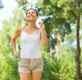 Running woman outdoor workout in a park Royalty Free Stock Image