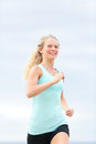 Running woman runner jogging outdoors happy smiling female jogger training outside as part of healthy lifestyle fresh beautiful Royalty Free Stock Photos