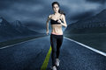 Running woman sporty runs on an empty road Royalty Free Stock Image