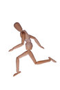 Running wooden mannequin a in position Royalty Free Stock Photo