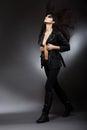 Runway fashion model walking on podium in black trendy garments elegance woman Stock Photos