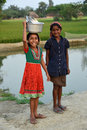 Rural adolescent two girl posed in an indian village Stock Photos