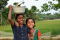 Rural adolescent two indian girl smiling in an indian village Stock Photos