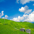 Rural alpine scenery landscape with wooden huts an beautiful sky Royalty Free Stock Photos