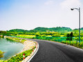 A rural asphalt road very clean highway through the lakes and mountains Royalty Free Stock Image