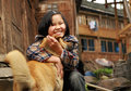 The rural chinese teenage girl plays with the ginger dog near a guangxi province china april years old hugging red village dazhai Royalty Free Stock Photos