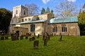 Rural church in the english countryside an isolated with grave stones foreground Royalty Free Stock Photos