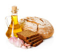 Rural country still life. Bread, sunflower oil Royalty Free Stock Photo