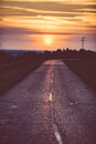 Rural countyside with beautifull sunset damaged road in Royalty Free Stock Photos