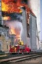 Rural Firefighters Battle Large Grain Bin Fire Royalty Free Stock Photo