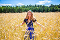 Rural girl young bavarian woman on the field wearing dirndl Royalty Free Stock Photos