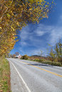 Rural highway in autumn vertical shot of Stock Images