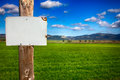 Rural informative post empty message closeup of in front of scenic field with space for text Royalty Free Stock Photography