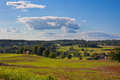 Rural landscape with a Farm and a fileld Royalty Free Stock Photo