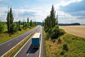 The rural landscape with a highway leading poplar alley Royalty Free Stock Photo