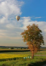 Rural landscape and hotair balloon Royalty Free Stock Photo