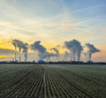 Rural landscape with an industry plant beyond in sunrise Royalty Free Stock Images