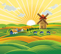 Rural landscape with a windmill. Royalty Free Stock Photo