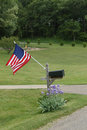 Rural patriotism the american flag attached to mailbox symbolizes holiday for all passing by their home Stock Photo