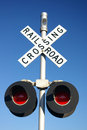 Rural rail road crossing sign with lamps Royalty Free Stock Photo