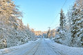 Rural road after snowstorm view of a in maine a with clear skies and snow covered Royalty Free Stock Photo