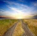 Rural road to sunset Royalty Free Stock Photo